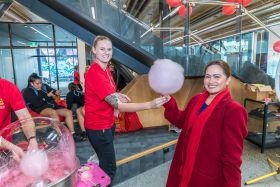 Handing out candy floss at Open Day